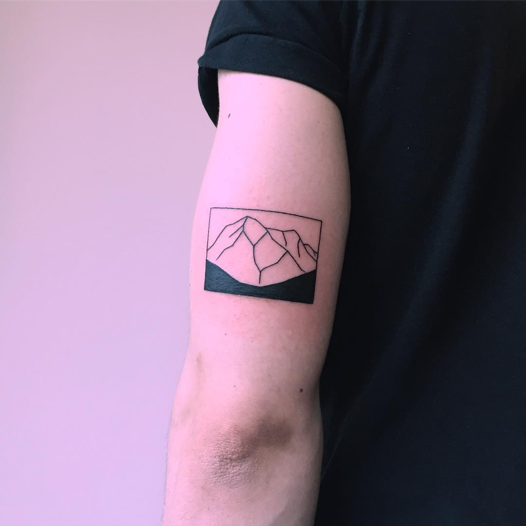Black and white mountain tattoo by Chinatown Stropky