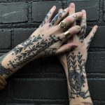 Black forearm patterns by Tine DeFiore