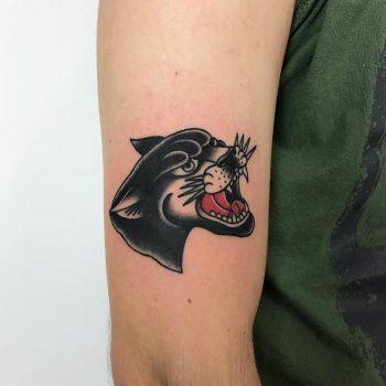 Classic panther head tattoo by Łukasz Krupiński