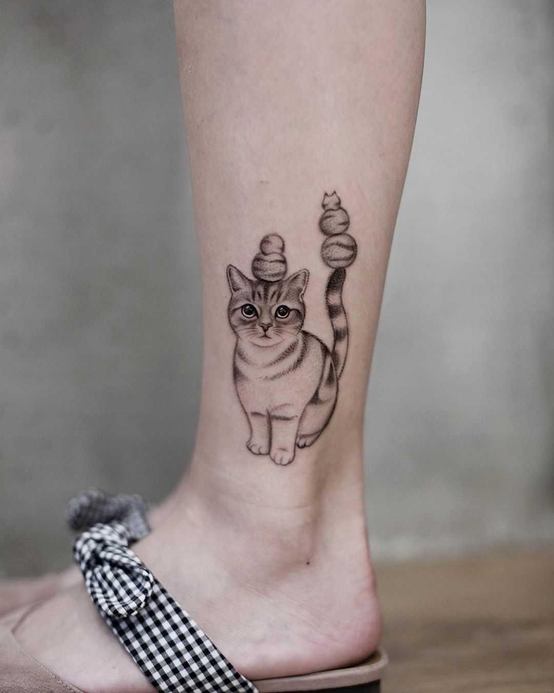Cute cat tattoo by Aki Wong