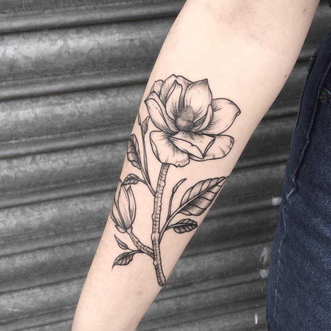 Delicate Magnolia tattoo by Lozzy Bones