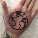 Earth tattoo on a palm by Luke.A.Ashley