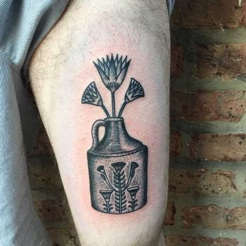 Egyptian Lotus in a moonshine jug by Tine DeFiore