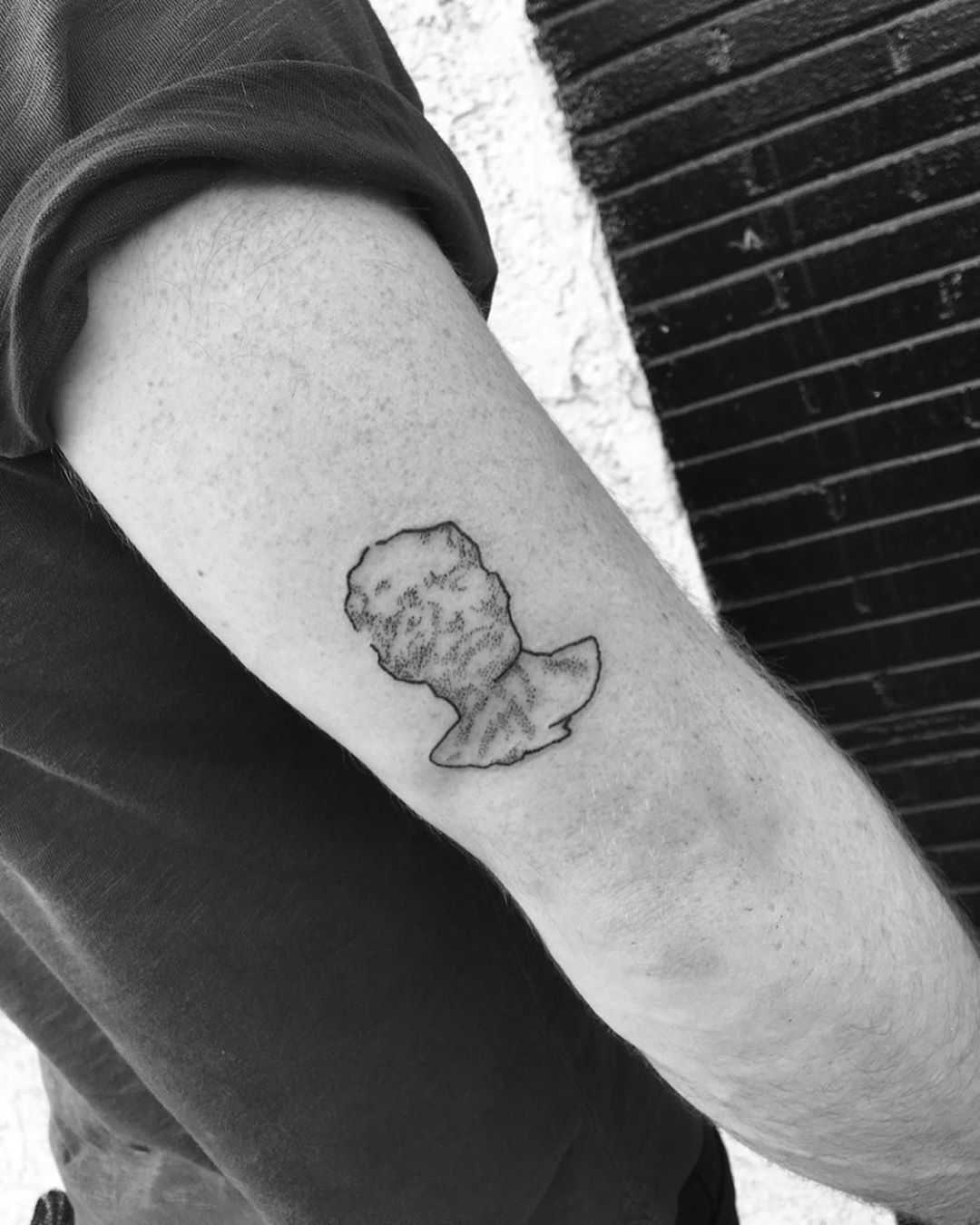Gustav Mahler's Death Mask tattoo by Robbie Ra Moore