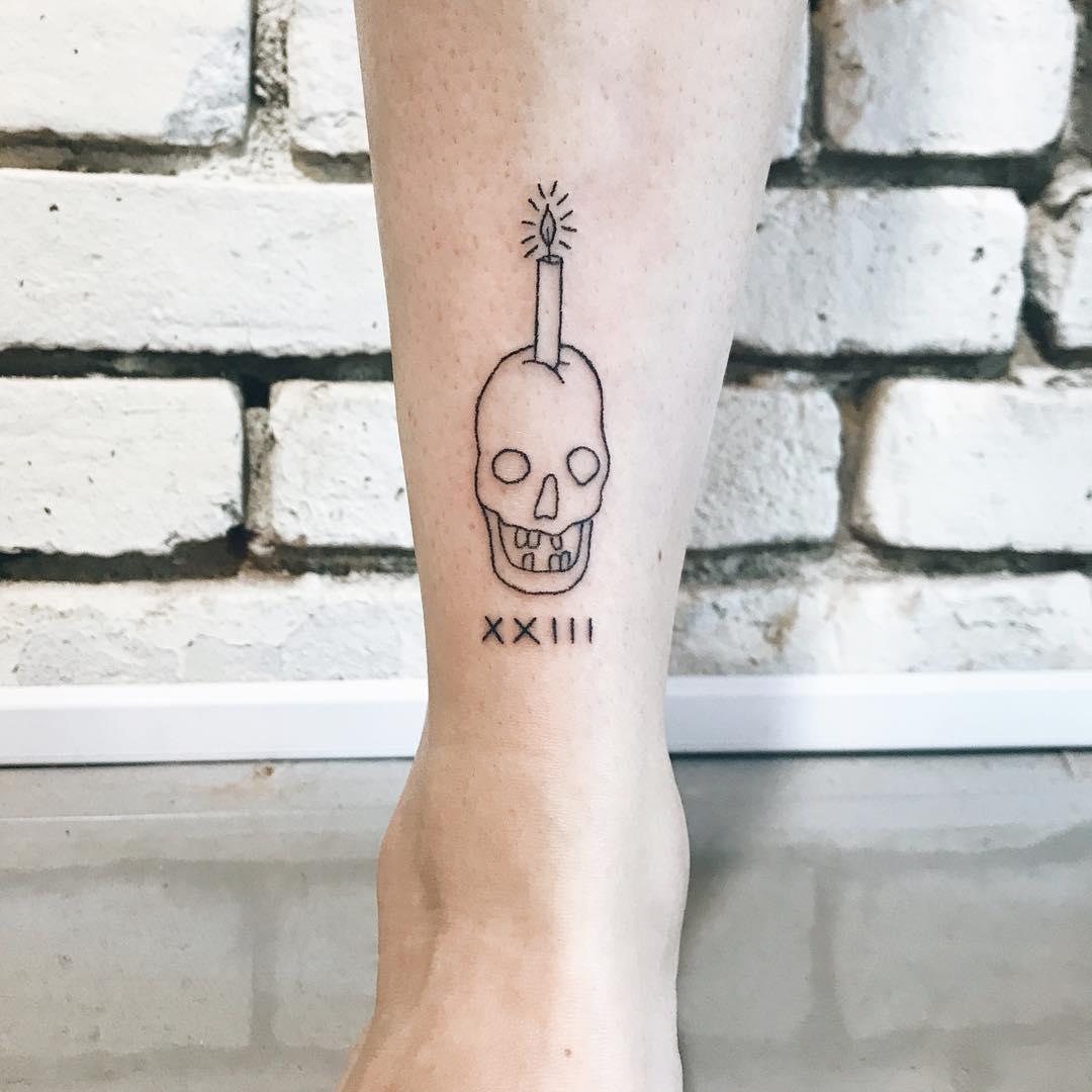 Hand-poked ankle crown by Kelli Kikcio