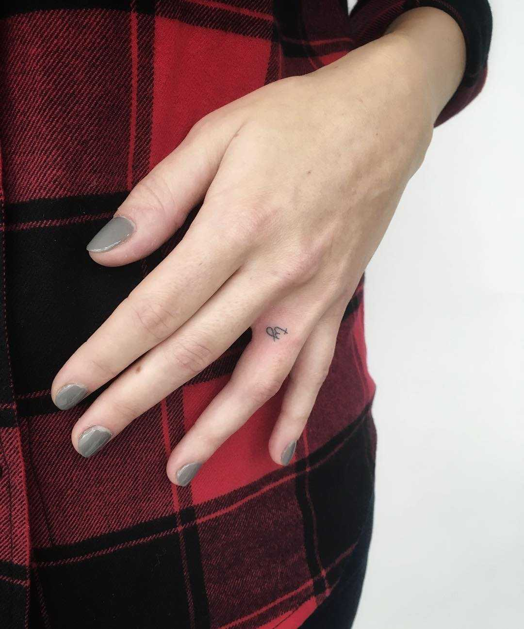 Hand-poked initials by Gianina Caputo