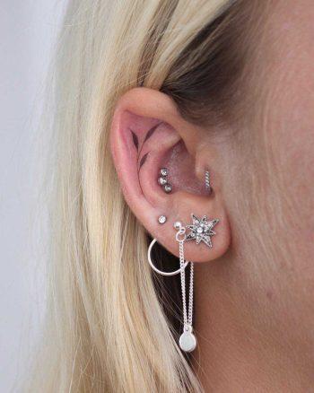 Hand-poked inner ear piece by Lara Maju