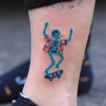 Hand-poked skateboarding skeleton by zzizziboy