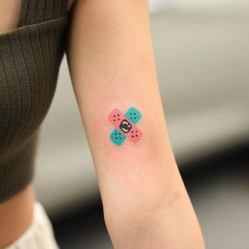 Hand-poked tiny band-aid tattoo by zzizziboy