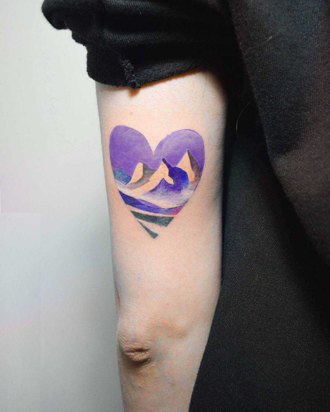 Heart-shaped mountain tattoo by Mavka Leesova