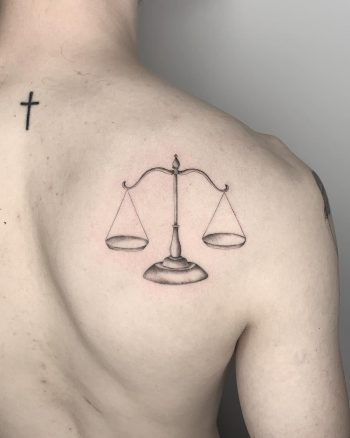 Justice tattoo by Conz Thomas