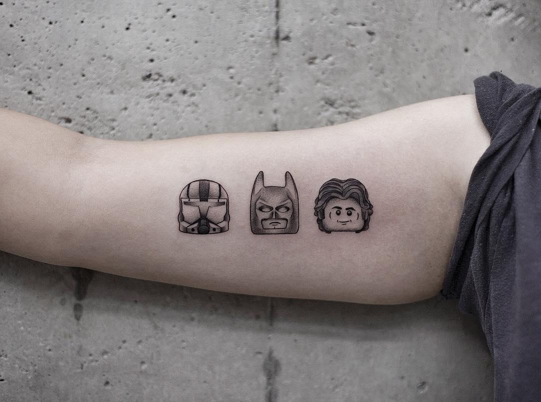 LEGO's minifigure head tattoos by Aki Wong