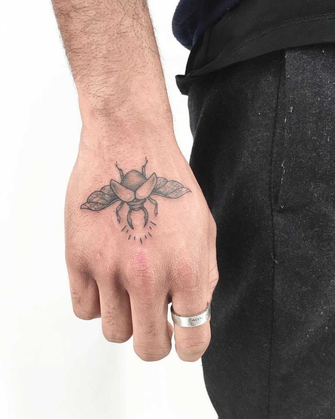 Little beetle tattoo by Gianina Caputo