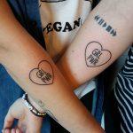 Matching GRL PWR tattoos by Lara Simonetta