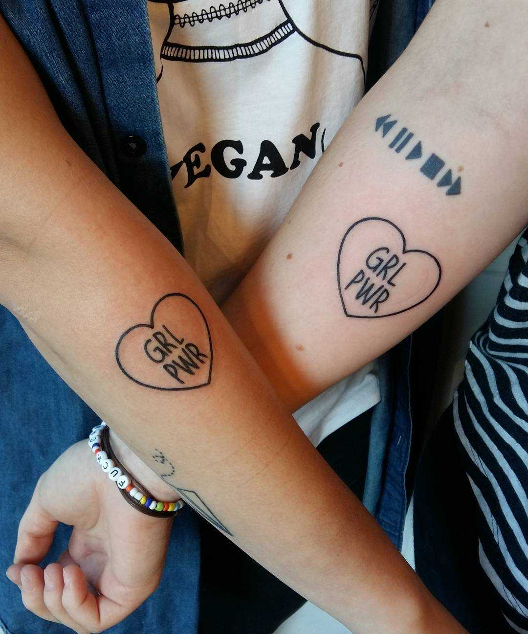 Matching GRL PWR tattoos by Lara Simonetta