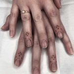 Matching finger tattoos by Tine DeFiore