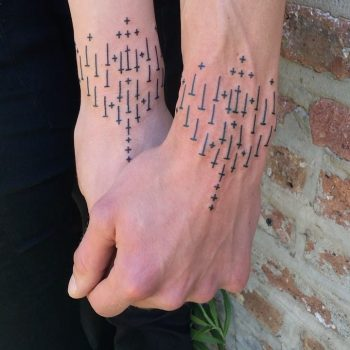 Matching pattern tattoos by Tine DeFiore