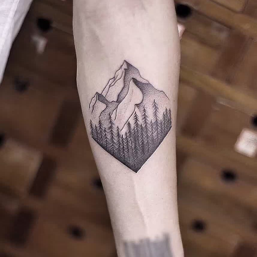 Mountains and trees tattoo by Aki Wong