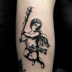 Naughty cherub tattoo by Loz McLean