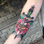 Old-school rose and dagger tattoo by Mike Nofuck