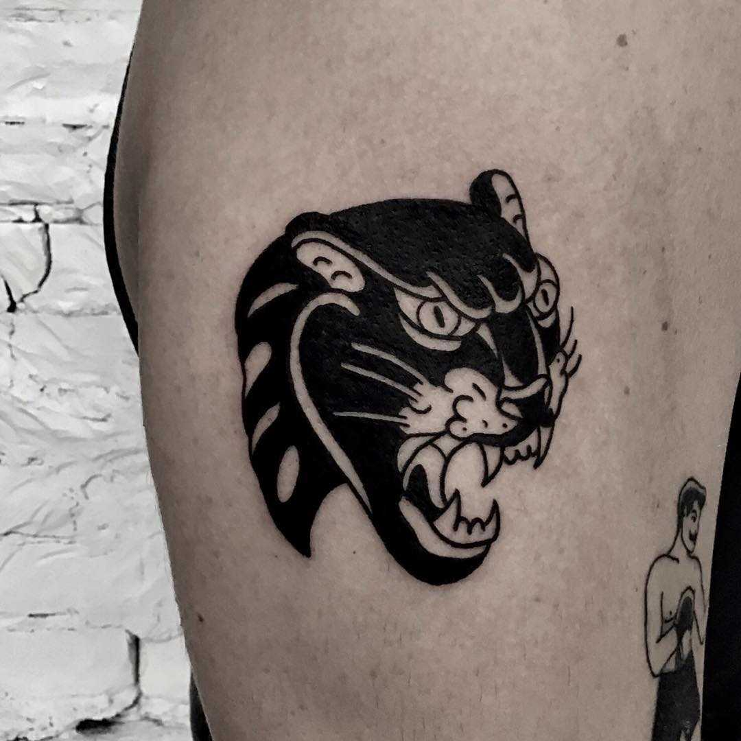 Panther tattoo by Kevin Jenkins