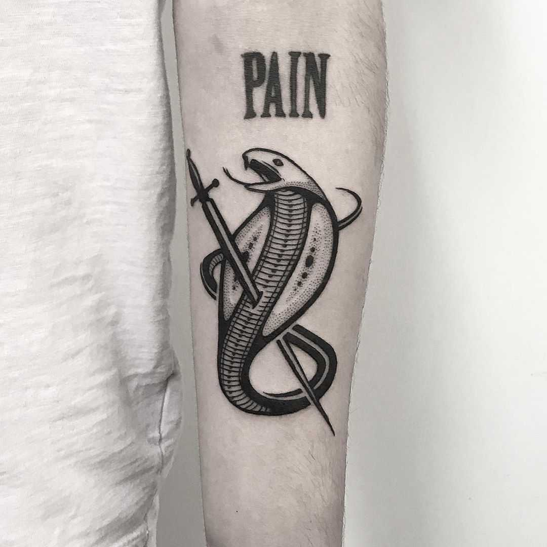 Pierced cobra tattoo by Pulled Poltergeist