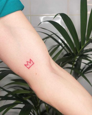 Red little crown tattoo by Loz Thomas