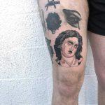 Sad statue tattoo by tattooist yeahdope