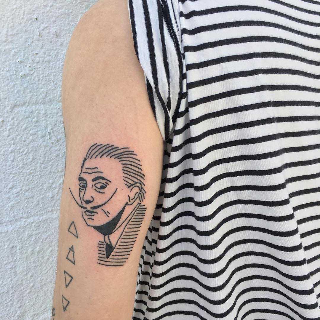 Salvador Dali tattoo by tattooist yeahdope