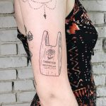 Shopping bag tattoo by Kelli Kikcio