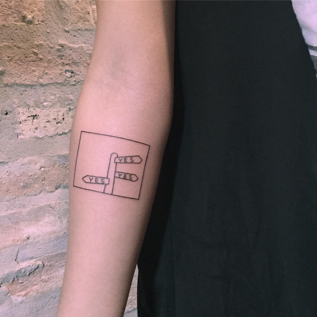 Signpost tattoo by Chinatown Stropky