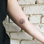 Small shell tattoo by Kelli Kikcio