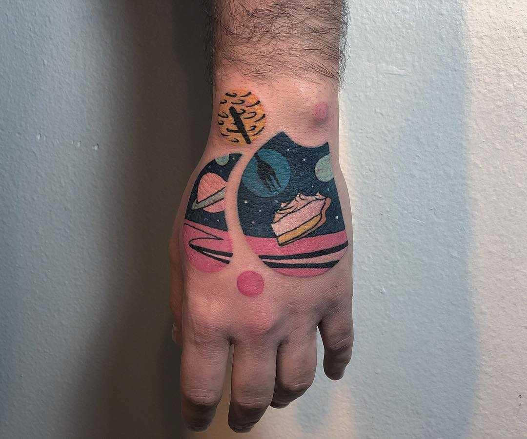 Space lemon pie tattoo by Eugene Dusty Past