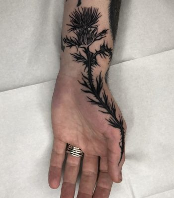 Thistle tattoo by Tine DeFiore