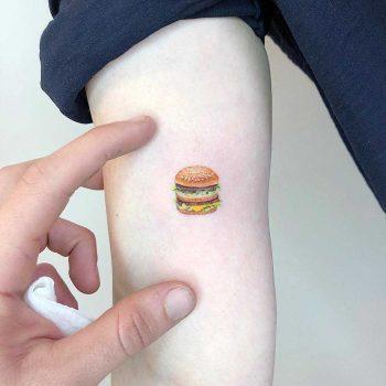 Tiny Big Mac tattoo by Eden Kozo