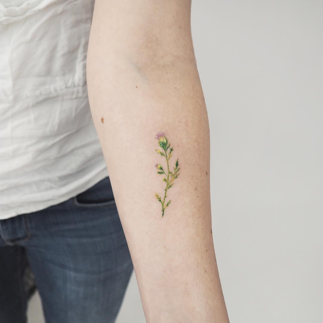 Tiny wildflower by anton1otattoo