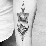Universe and mountains tattoo by Amanda Piejak