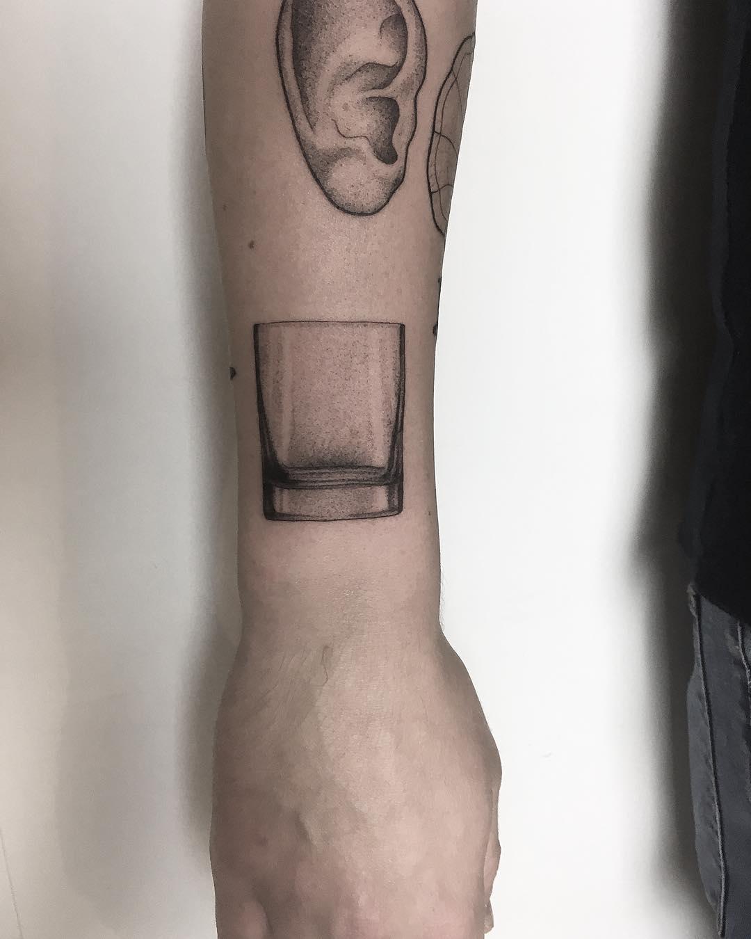 Whiskey tumbler tattoo by tattooist Spence @zz tattoo