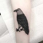A blackwork bird tattoo by Deborah Pow