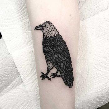 A blackwork bird tattoo by Deborah Pow