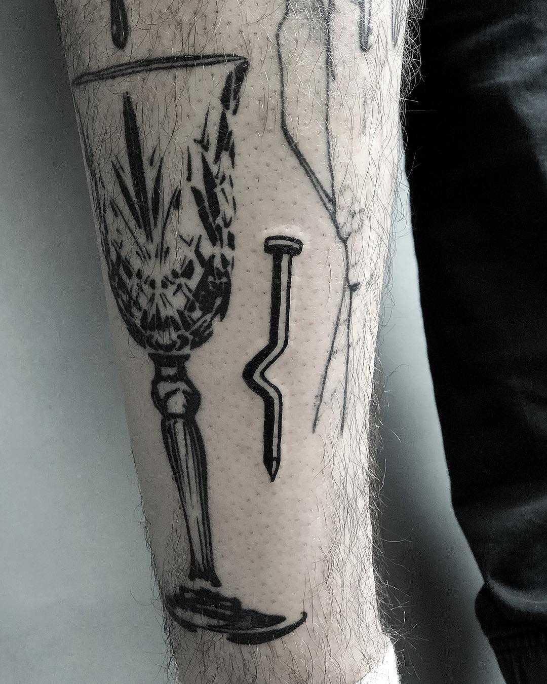 Bent nail tattoo by Loz McLean