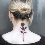 Black rose tattoo on the back by Loz McLean