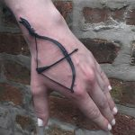 Bow and arrow tattoo by Tine DeFiore