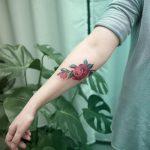 Camellia flower tattoo by Mavka Leesova