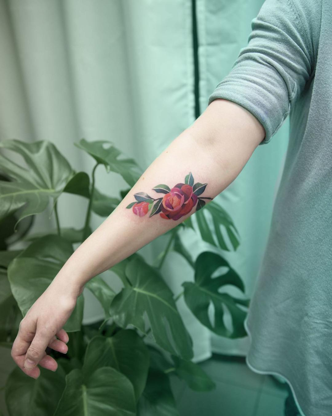 Camellia flower tattoo by Mavka Leesova