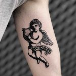 Cherub with a harp by Loz McLean
