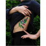 Colorful leaf tattoo by Mavka Leesova