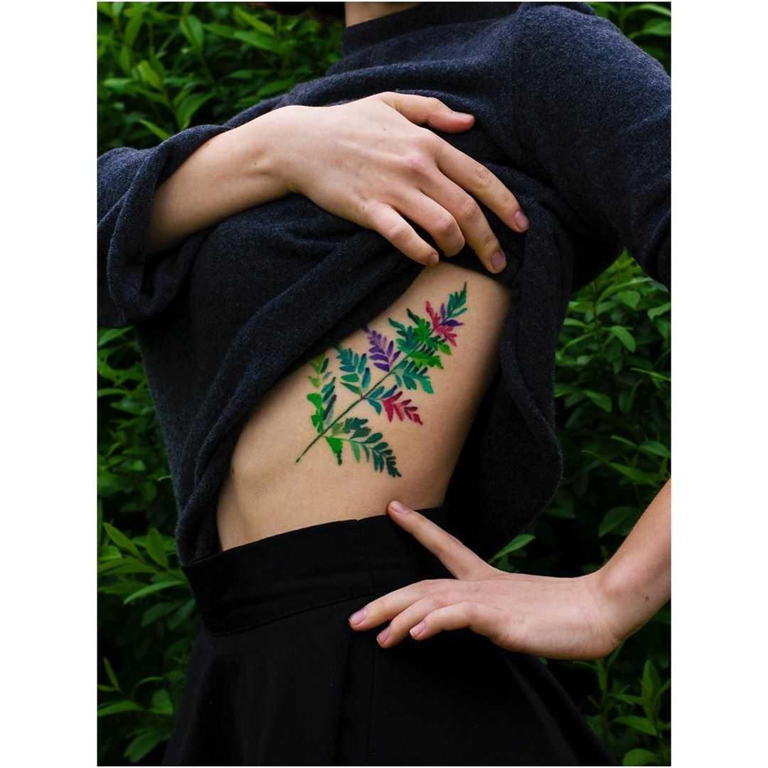 Colorful leaf tattoo by Mavka Leesova
