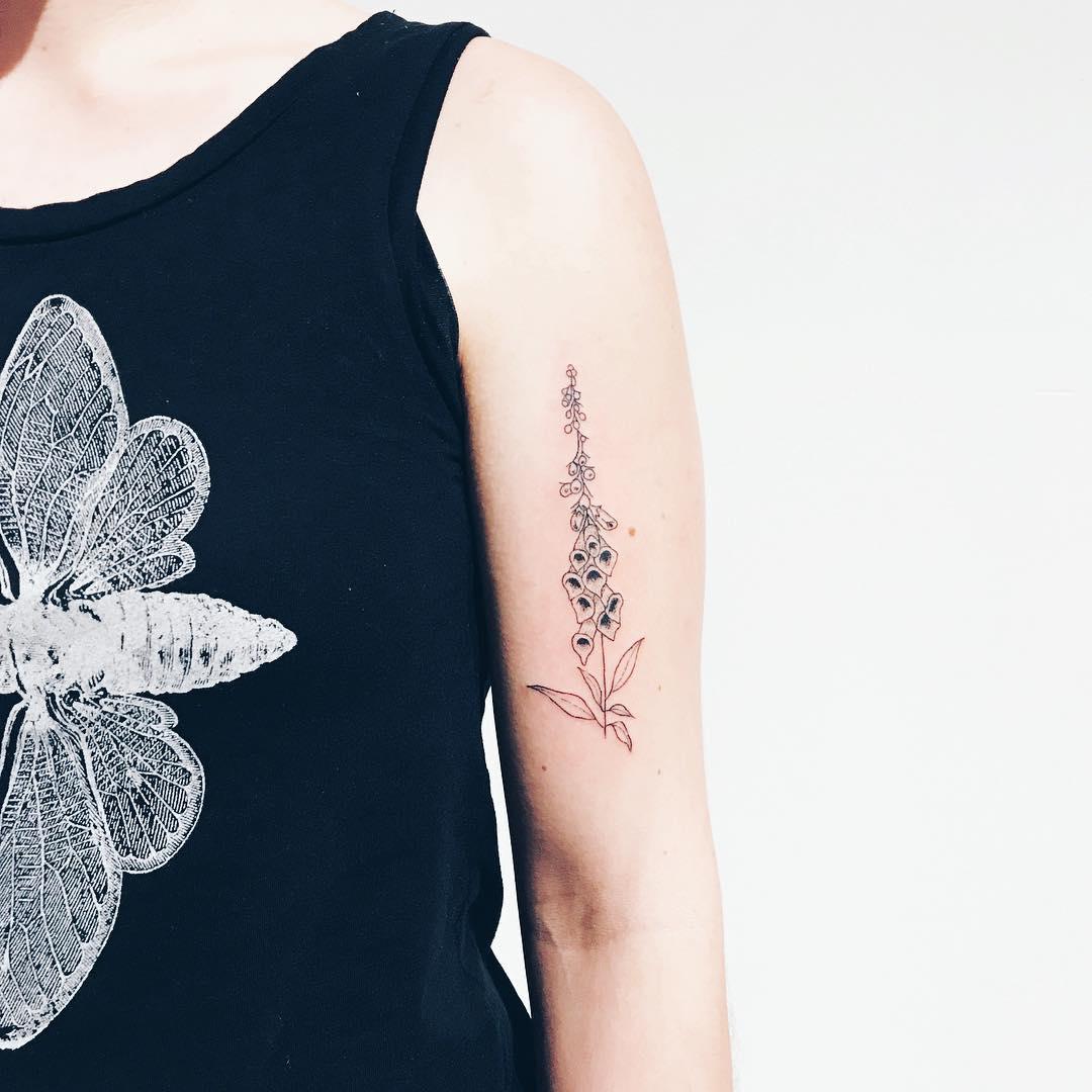 Delicate foxglove tattoo by Kelli Kikcio