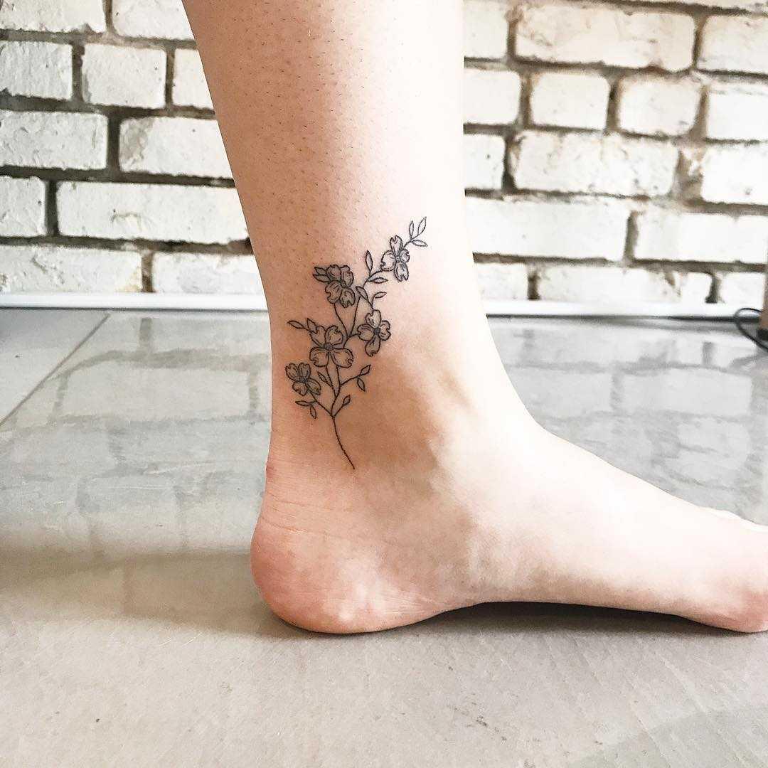 Dogwood branch tattoo by Kelli Kikcio